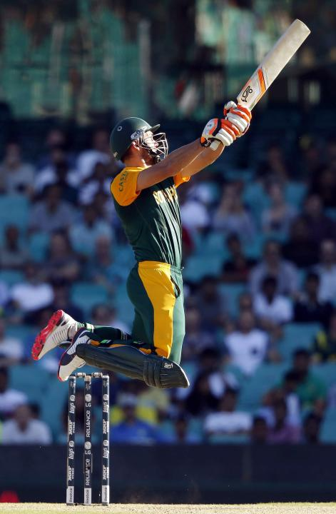South Africa's Rilee Rossouw jumps as he hits a boundary during the Cricket World Cup match against the West Indies at the SCG