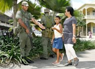 Soldiers chat to locals in Suva in 2006. Fiji on Wednesday defended the army's role in preparations for the Pacific nation's first elections since a 2006 military coup, saying there was no other way to lay the groundwork for the vote in 2014