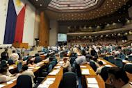 Members of the Philippine house of representatives vote to terminate heated debates on a controversial birth control law, in Manila on August 6, 2012. Philippine lawmakers passed a version of the bill after a long debate over an issue that has deeply polarised the largely Catholic nation (AFP News)