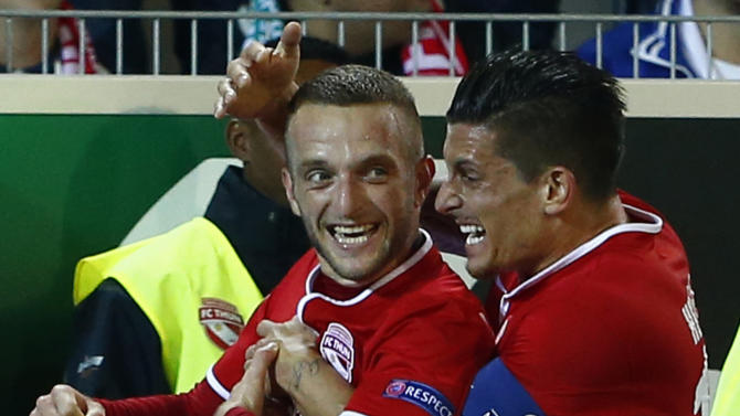 FC Thun's Christian Schneuwly reacts with captain Dennis Hediger after scoring his first goal against Rapid Vienna during their Europa League soccer match at the Thun arena in Thun