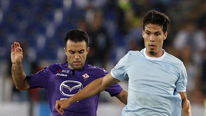 Lazio midfielder Hernanes, of Brazil, is challenged by Fiorentina forward Giuseppe Rossi, left, during a Serie A soccer match between Lazio and Fiorentina, at Rome's Olympic stadium, Sunday, Oct. 6, 2013