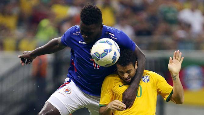 Felipe Andreson of Brazil's Olympic team fights for the ball with Jean Andrew of Haiti's national team during their international friendly soccer match at the Arena da Amazonia stadium in Manaus