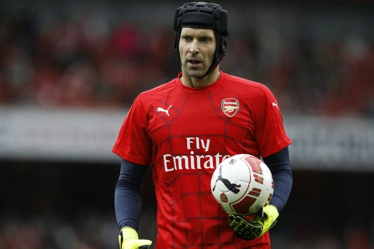 Arsenal's Petr Cech warms up ahead of the pre-season friendly against Wolfsburg at the Emirates Stadium in north London, on July 26, 2015