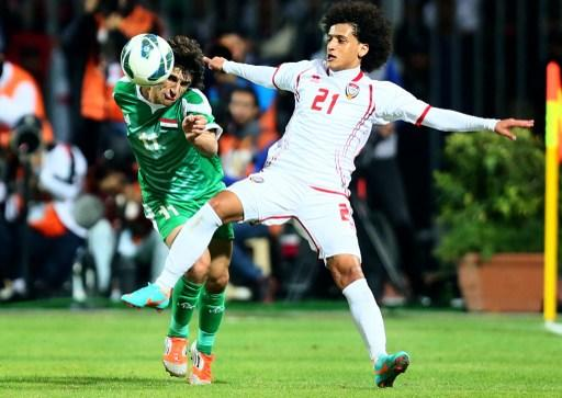 Humam Tariq Faraj (L) of Iraq vies with Omar Abdelrahman of UAE as he attempts to score during the 21st Gulf Cup's final between United Arab Emirates (UAE) and Iraq on January 18, 2013 in Manama. Unit
