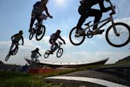 Australia's Marc Willers (R), Switzerland's Roger Rinderknecht (C, #13), Joris Daudet (Upper #2) of France, Nicholas Long of the US (L,#64) and compatriot David Herman (lower, 2nd L, #5) compete during the men's BMX cycling heat at the London 2012 Olympic Games, in London on August 9, 2012