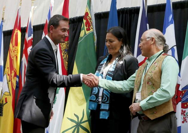 P.E.I. Premier Robert Ghiz (L) shakes hands with Metis National Council president Clement Chartier.