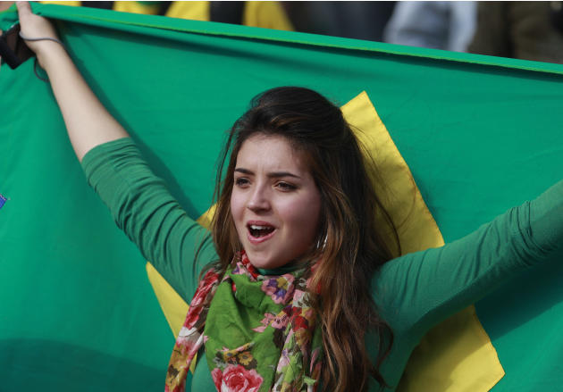 A Brazilian soccer fan cheers at before the start of a Group B Copa America soccer match between Brazil and Paraguay in Cordoba, Argentina, Saturday July 9, 2011. (AP Photo/Victor R. Caivano)