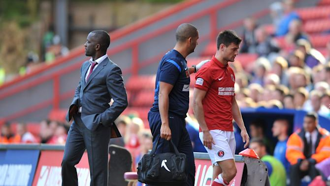 Johnnie Jackson, right, leaves the field injured on Saturday