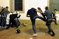 Demonstrators clash with riot police in front of Rio de Janeiro's legislative building on June 17, 2013. Police used tear gas, pepper spray and rubber bullets to disperse small groups of masked youths engaging in acts of vandalism near the assembly