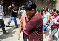 "Relatives of inmates at the ""Sagrado Corazon de Jesus"" rehabilitation centre for drug and alcohol addicts react, after a fire swept through the place killing 14 in Lima. The sole survivor of the blaze, Luis Zeballo, told reporters he smelled smoke and felt heat in the early morning and ran out of the building"