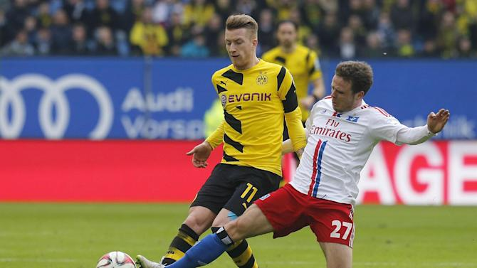 Bundesliga - Reus will stay at Dortmund, say agents