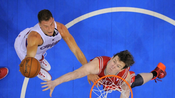 Los Angeles Clippers forward Blake Griffin, left, puts up a shot as Houston Rockets center Omer Asik, of Turkey, defends during the first half of an NBA basketball game, Wednesday, Feb. 26, 2014, in Los Angeles. (AP Photo/Mark J. Terrill)