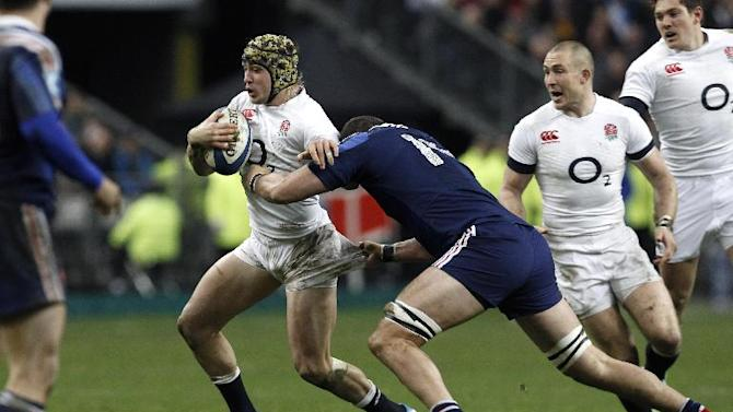 England's Jack Nowell is tackled by France's Yoann Maestri, during their Six Nations rugby union international match, at the Stade de France, in Saint Denis, outside Paris, Saturday, Feb 1, 2014. France defeated England 26-24