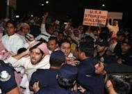 Kuwaiti police push back hundreds of demonstrators protesting against a film deemed offensive to Islam near the US embassy in Kuwait City. About 500 demonstrators gathered waving a black Al-Qaeda flag