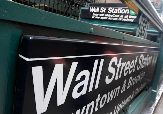 FILE - This Oct. 2, 2014 file photo shows the Wall Street subway stop on Broadway, in New York's Financial District. The U.S. economy went into reverse in the first three months of this year as a