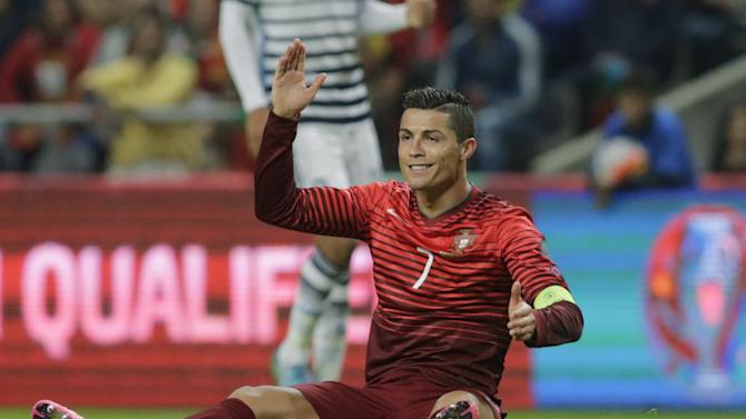 Portugal's Ronaldo reacts during their Euro 2016 qualifying soccer match against Denmark at Municipal Stadium in Braga
