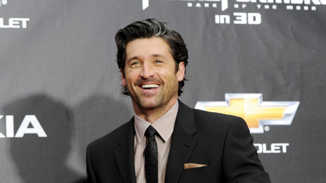 """FILE - In this June 28, 2011 file photo, actor Patrick Dempsey attends the """"Transformers: Dark Of The Moon'"""" premiere in Times Square in New York.  Dempsey announced on Wed., Dec. 26, 2012, that he is leading a group attempting to save hundreds of jobs by buying Seattle based Tully's Coffee. (AP Photo/Evan Agostini, File)"""
