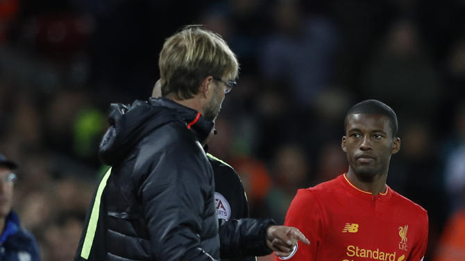 Liverpool's Georginio Wijnaldum waits to come on as a substitute as manager Juergen Klopp looks on