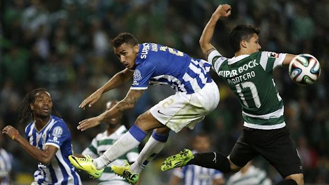 Sporting's Montero, from Colombia, right, and Porto's Danilo, from Brazil, jump for the ball during their Portuguese league soccer match Sunday, March 16, 2014, at Sporting's Alvalade stadium in Lisbon