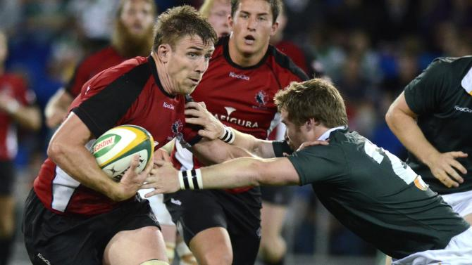 The Australian Barbarian's Luke Morahan, right, tackles Canada's Chauncey O'Toole during their rugby union match on the Gold Coast, Australia, Friday, Aug. 26, 2011. (AP Photo/Steve Holland)