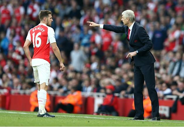 Arsenal manager Arsene Wenger (R) gestures towards midfielder Aaron Ramsey during the Premier League match against Manchester United at the Emirates Stadium on October 4, 2015