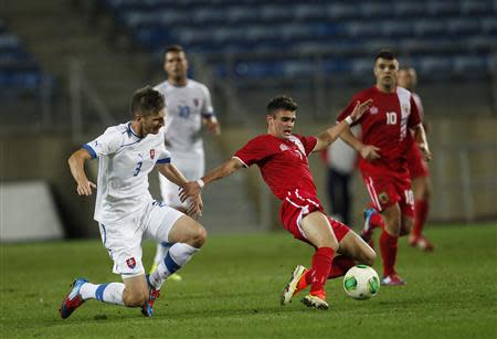 Gibraltar's Lopez fights for the ball with Slovakia's Farkas during their international friendly soccer match near Faro
