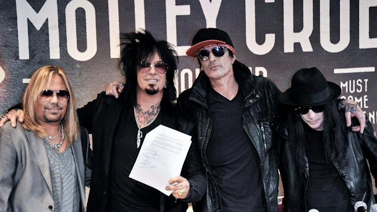 From left, Vince Neil, Nikki Sixx, Tommy Lee, and Mick Mars attend the Motley Crue Press Conference, Tuesday, Jan. 28, 2014, in Los Angeles. (Photo by Richard Shotwell/Invision/AP)