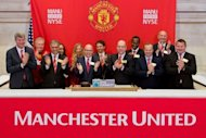Manchester United Executives as they ring the Opening Bell at the New York Stock Exchange in New York City. Manchester United shares barely treaded water in debut trade in New York Friday even after underwriters slashed the IPO price amid doubts