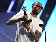 Chris Brown accepts the award for best male R& B at the BET Awards on Sunday, July 1, 2012, in Los Angeles. (Photo by Matt Sayles/Invision/AP)