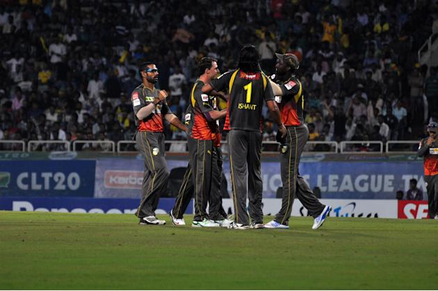 Players of Sunrisers Hyderabad celebrates after taking wicket during match against Titans at Karbonn Smart Champions League Twenty-20 Match at Jharkhand State Cricket Association (JSCA) International