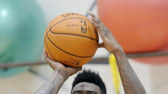 New York Knicks' Iman Shumpert practices his at the teams NBA basketball training camp Tuesday, Oct. 1, 2013, in Greenburgh, N.Y