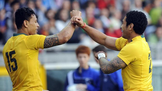 Australia's Joe Tomane and Israel Folau celebrate after winning their Six Nations rugby union match against Italy at the Olympic stadium in Turin