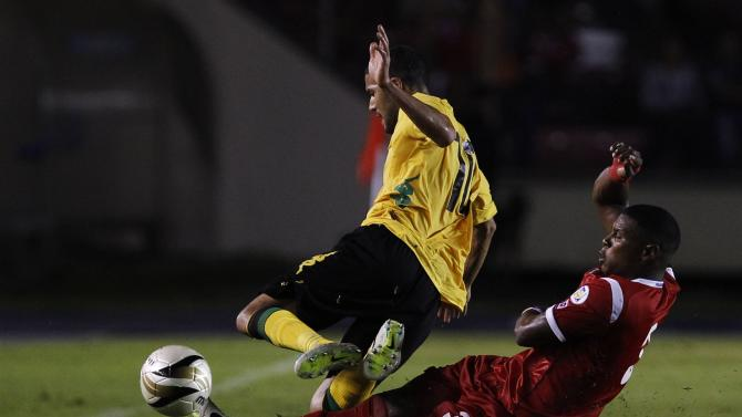 Panama's Cummings fights for the ball with Jamaica's McAnuff during their 2014 World Cup qualifying soccer match in Panama City