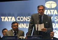 """Chairman of Tata Consultancy Services, Ratan Tata (R) speaks during the annual general meeting of TCS in Mumbai. TCS warned Friday of """"weakness"""" in global markets, marking the latest downbeat comment to emerge from the country's flagship software industry"""
