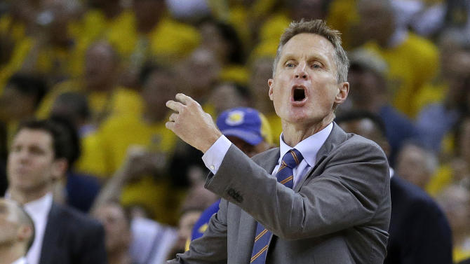 Golden State Warriors coach Steve Kerr gestures during the second half of Game 5 of the NBA basketball Western Conference finals against the Houston Rockets in Oakland, Calif., Wednesday, May 27, 2015. (AP Photo/Ben Margot)