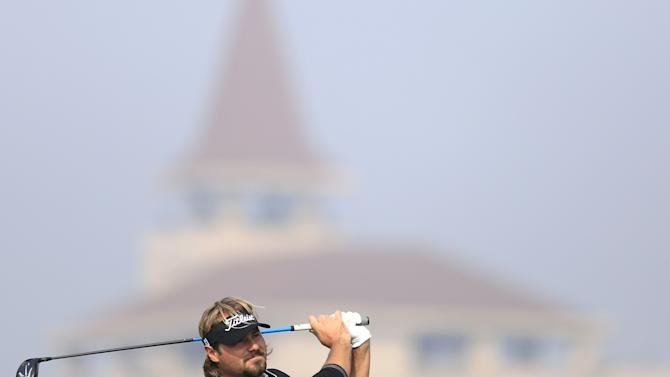 Victor Dubuisson of France tees off on the second hole during the third round of the BMW Masters 2015 golf tournament at Lake Malaren Golf Club in Shanghai