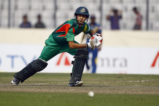Bangladesh's Nasir Hossain plays a shot on the third one day international cricket against Sri Lanka in Dhaka, Bangladesh, Saturday, Feb. 22, 2014. (AP Photo/A.M. Ahad)