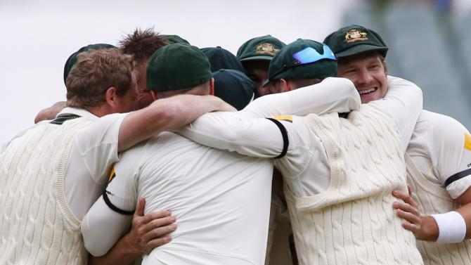 Australia's team celebrate after taking the wicket of England's Panesar as a last wicket and winning the second Ashes cricket test at the Adelaide Oval