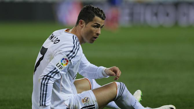 Real's Cristiano Ronaldo on the turf during a semi final, 2nd leg, Copa del Rey soccer match between Atletico de Madrid and Real Madrid at the Vicente Calderon stadium in Madrid, Spain, Tuesday, Feb. 11, 2014