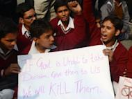 Indian school students shout anti-government slogans during a protest calling for better safety for women following the rape of a student in the Indian capital, in New Delhi on December 26, 2012. India's government ordered a special inquiry Wednesday into the gang-rape of a student which sparked mass protests, as police announced the arrest of 10 men over another multiple sex assault.