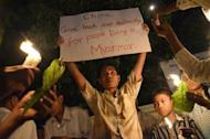 A man holds up a placard during a protest in Mandalay on May 21 against severe power cuts. People in the country formerly known as Burma are testing the boundaries of their freedom under the quasi-civilian government which took power last year
