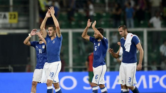 Italy's players celebrate at the end of their World Cup qualifying soccer match against Bulgaria at the Renzo Barbera Stadium in Palermo