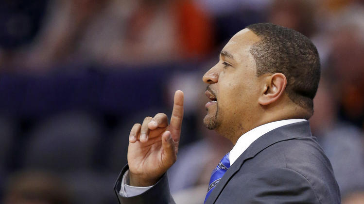 Golden State Warriors' Mark Jackson gives instructions to his players during the first half of an NBA basketball game against the Phoenix Suns, Saturday, Feb. 8, 2014, in Phoenix