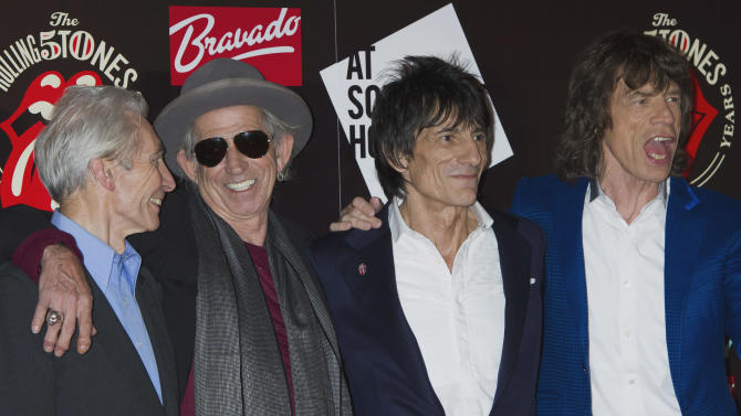 FILE -This Thursday, July 12, 2012 file photo shows, from left, Charlie Watts, Keith Richards, Ronnie Wood and Mick Jagger, from the British Rock band, The Rolling Stones, as they arrive at a central London venue, to mark the 50th anniversary of the Rolling Stones first performance.  The legendary band said Monday it would return to the stage this year with four concerts in New York and London. The shows mark the first time in five years at the Stones have performed live, with Mick Jagger, Keith Richards, Charlie Watts and Ronnie Wood all coming together once more.  (AP Photo/Jonathan Short)