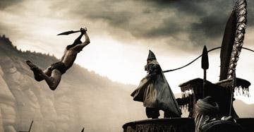 Stelios ( Michael Fassbender ) leaps over several guards to counter the attack of the Persian emissary in Warner Bros. Pictures' 300