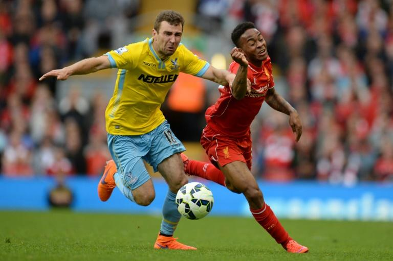 Crystal Palace's Scottish midfielder James McArthur (L) during the English Premier League football match against Liverpool on May 16, 2015