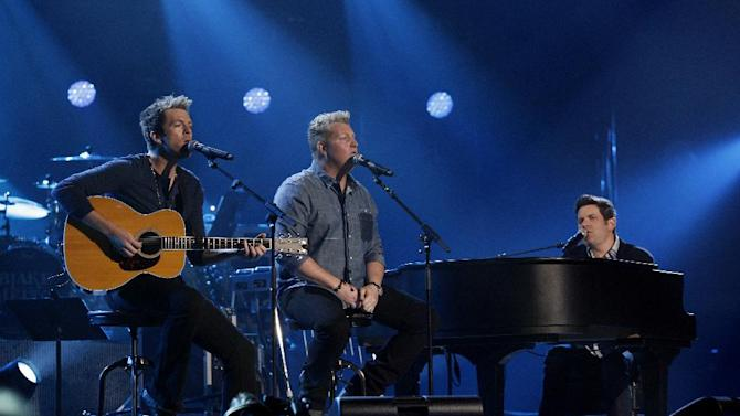 This image released by NBC Universal shows members of Rascal Flatts, from left, Joe Don Rooney, Gary LeVox and Jay DeMarcus during the Healing in the Heartland: Relief Benefit Concert at the Chesapeake Energy Arena in Oklahoma City, Okla., Wednesday, May 29,2013. Funds raised by the benefit will go to the United Way of Central Oklahoma, for recovery efforts for those affected by the May 20 tornado. (AP Photo/NBC, Brett Deering)