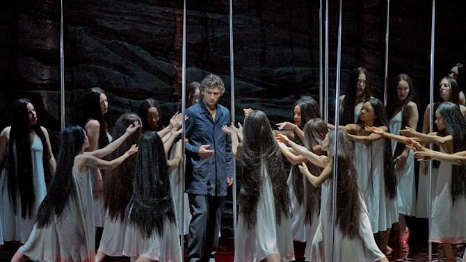 """In this photo provided by the Metropolitan Opera, Jonas Kaufmann rehearses the title character of Wagner's """"Parsifal,"""" Feb. 8, 2013 in New York. Though traditionalists may object, this is a """"Parsifal"""" to treasure, elevated to the highest musical level by the solemnity and sweep of Daniele Gatti's conducting and the dedication of a dream cast of singing actors, headed by tenor Jonas Kaufmann in the title role. (AP Photo/Metropolitan Opera, Ken Howard)"""