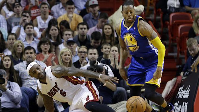 Miami Heat's LeBron James (6) loses control of the ball which was recovered by Golden State Warriors' Andre Iguodala (9) during the second half of an NBA basketball game, Thursday, Jan. 2, 2014, in Miami. The Warriors defeated the Heat 123-114