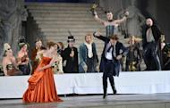 """Nicholas Ofczarek (right) in the role of Jedermann and Birgit Minichmayr in the role of Paramour perform during a rehearsal of """"Jedermann"""" (Everyman) on the Domplatz in Salzburg, Austria on July 19, ahead of the 2012 Salzburg Festival. The famed festival has ended, having marked up record ticket sales, after a month and a half of music, operas and concerts featuring top international names"""